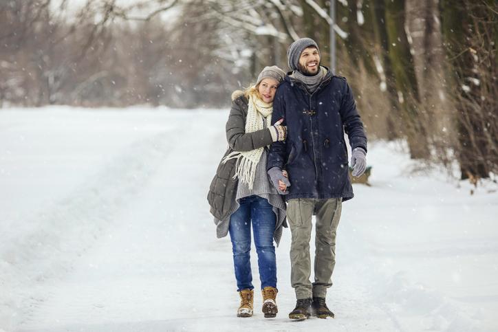Boyfriend and girlfriend walking in the park on a beautiful Winter day