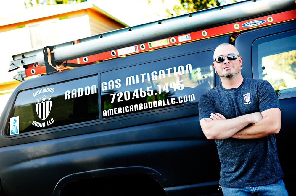 John Cardos with service truck for radon Mitigation and testing in the Denver Metro Area