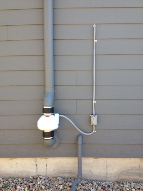 Radon mitigation fan installed in Longmont, CO
