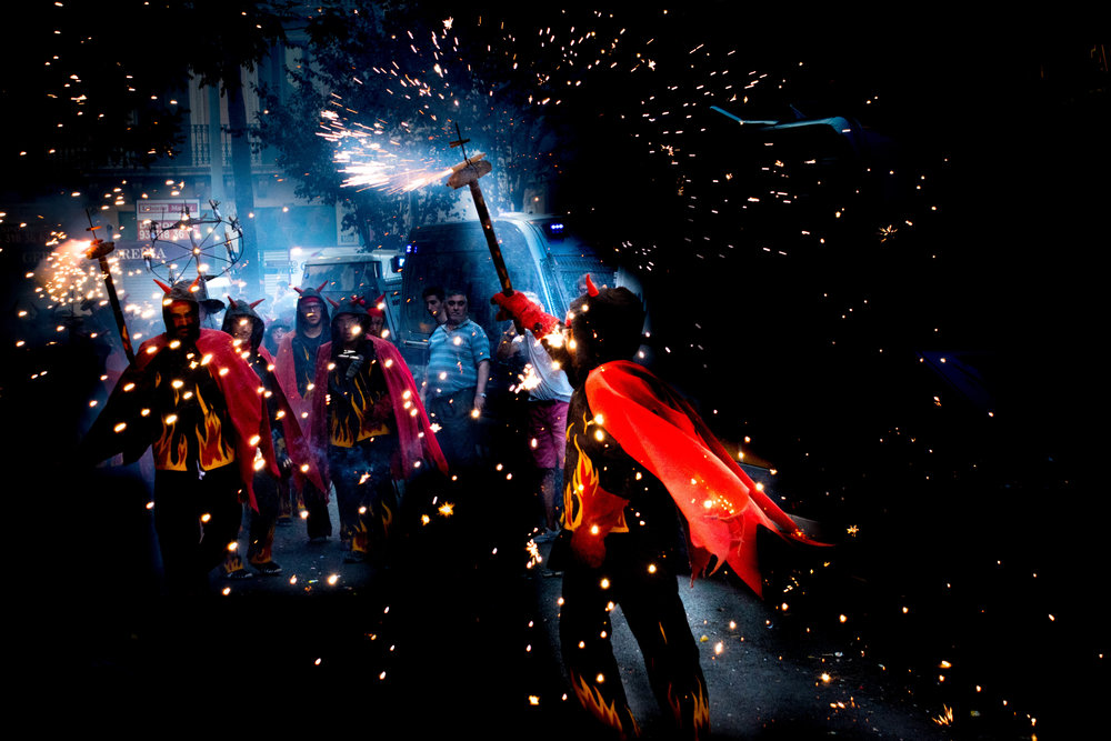 Correfoc - This photo of a Catalonian fire run was selected for an exhibit as part of a local high school photography competition. I took this photo on my Nikon D5500 and edited it entirely in Lightroom.