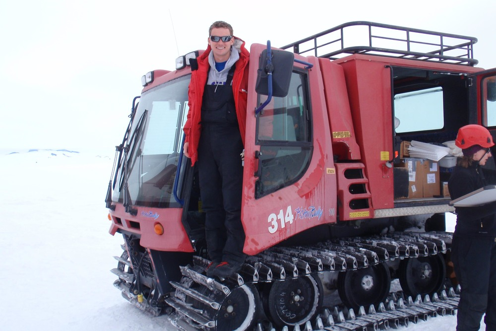 Peyton Adkins drives a Pisten Bully, one of the team's modes of transport from McMurdo to the drill test site. PHOTO BY TRISTA VICK-MAJORS