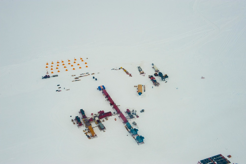 The camp at Subglacial Lake Whillans, with yellow tents for sleeping and red shipping containers for the drill and labs. PHOTO BY J.T. THOMAS