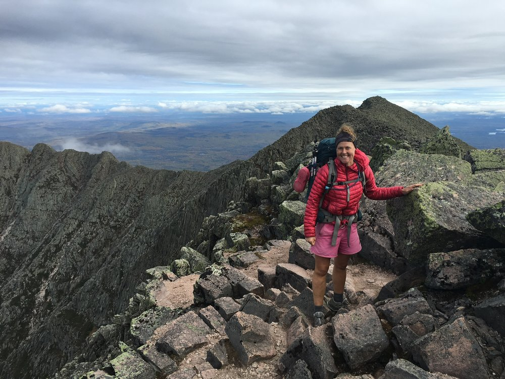 Laura Johnston, head of Out There's ambassador program, finishes a thru-hike of the Appalachian Trail at Mt. Katahdin. (Photo courtesy Laura Johnston)
