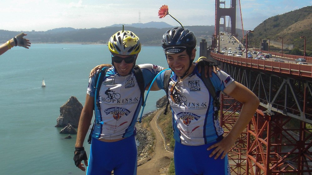Raffi (left) and Ersin (right) finsih a cross-country bicycle trip at the Golden Gate Bridge in California. (Photo courtesy Raffi Wartanian)