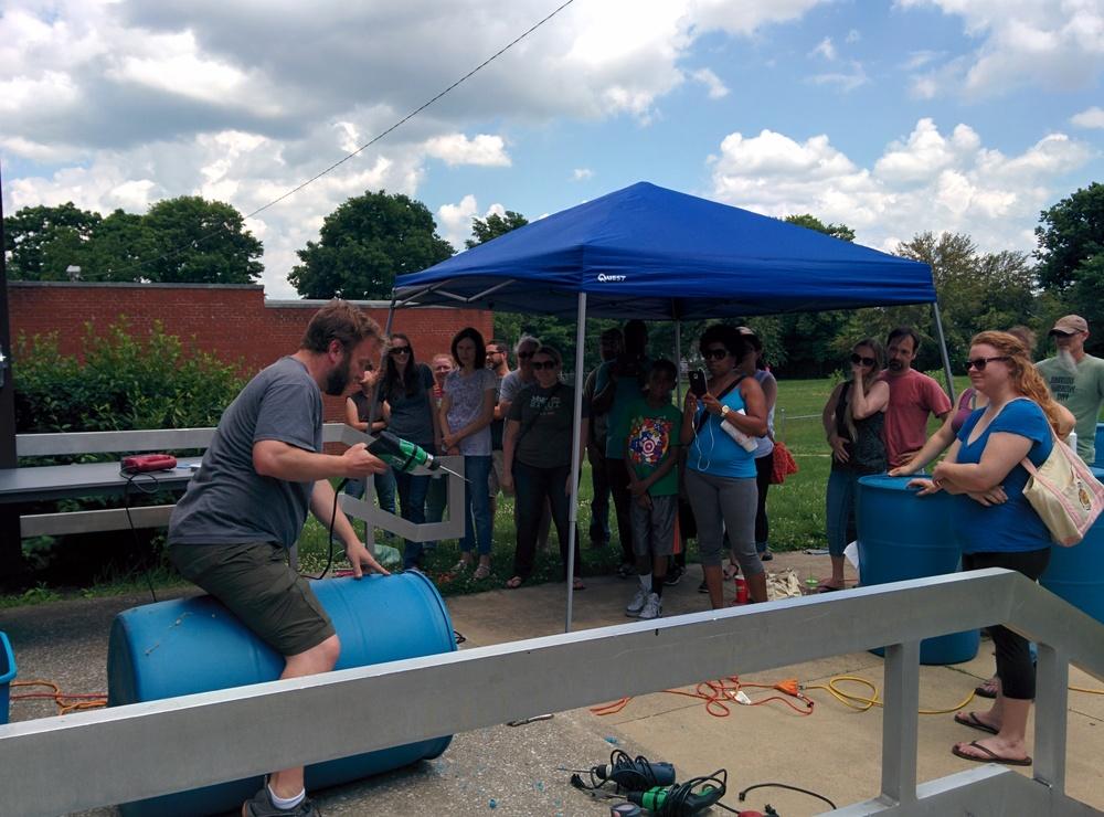 Schuyler Warren of Bluegrass Greensource emonstrating how to create a Rain Barrel
