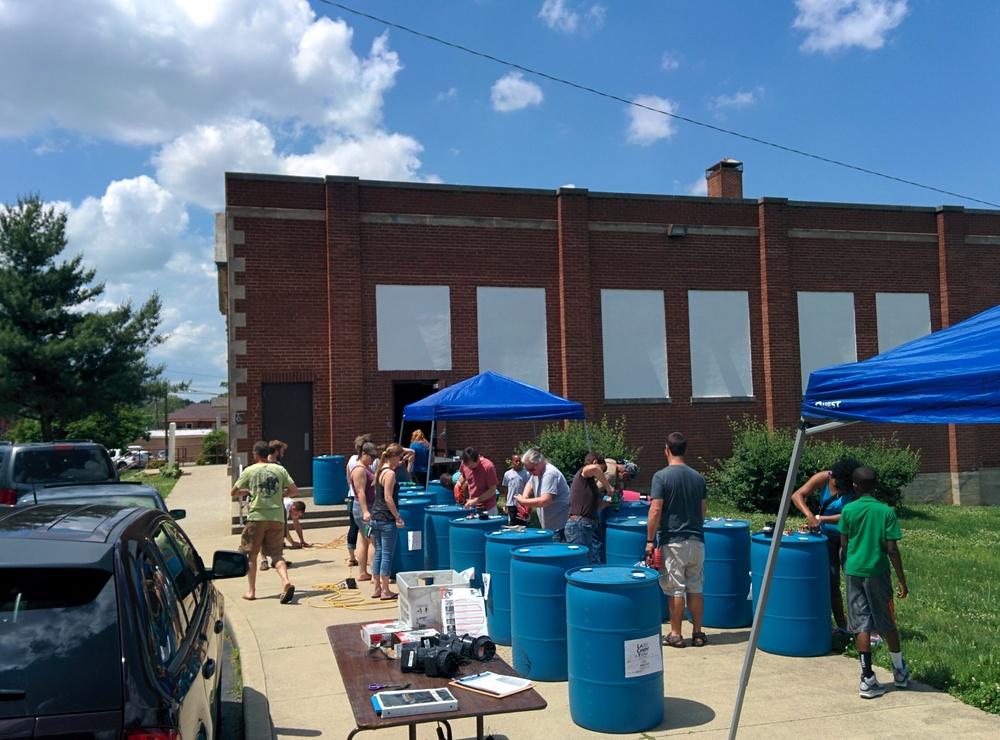 Neighborhood residents selecting their Rain Barrels