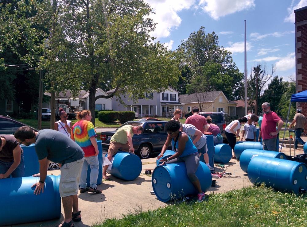 Neighborhood residents making their Rain Barrels