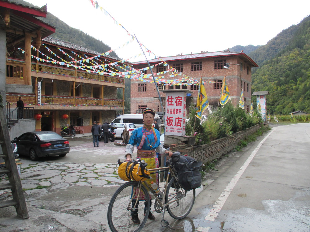 Industrious Tibetan guest house manager , Sichuan alps