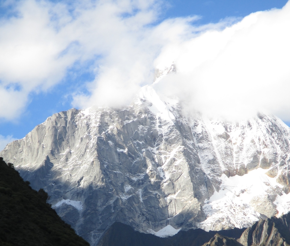Siguniang Shan 6250m granite wall in the Qohglai mountains also called the Sichuan Alps