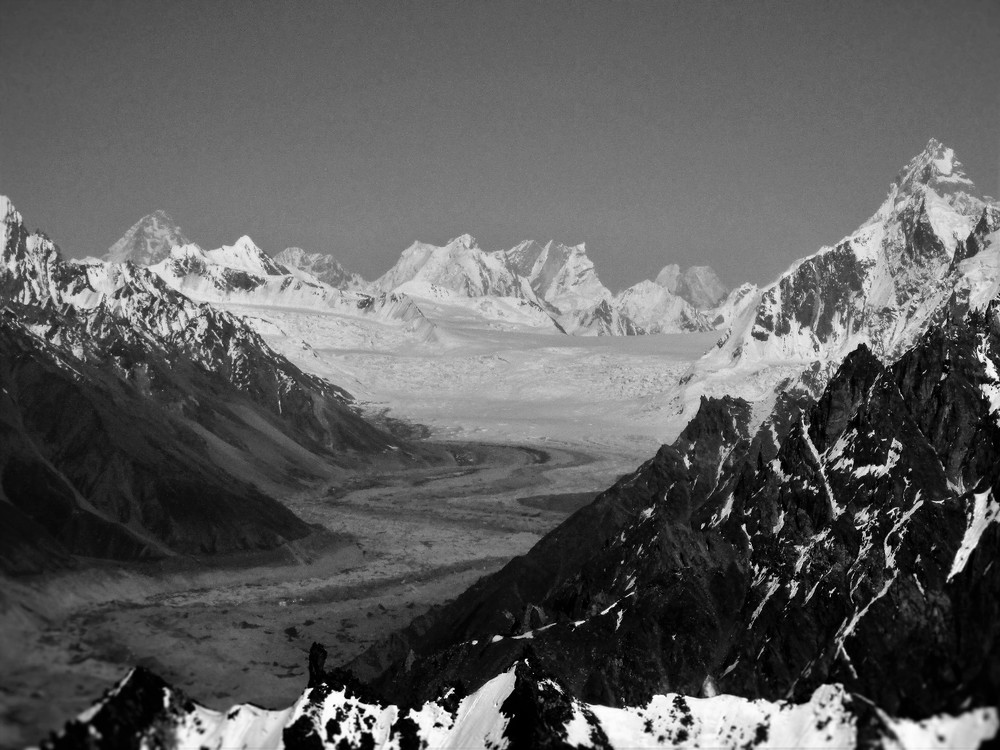 Looking up the Hispar Glacier from the Rush ridge. The high point is Snow lake at 5100 m , Far beyond in Silhouette K2, Broad Peak, Gasherbrum 4 and Gasherbrum 2. I changed this too Black and White as the scene reminded me of photos the first explorers had taken of these areas over a century ago.