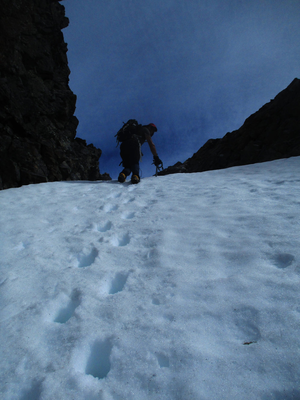 stepping up the final slope to the col.