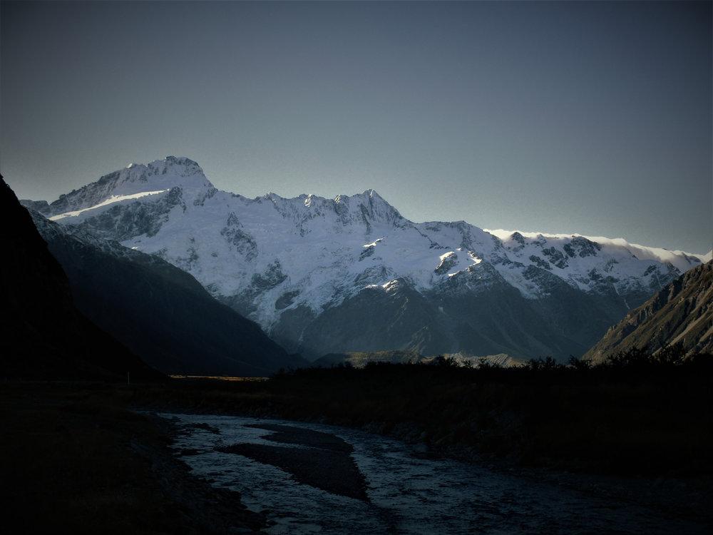 Mount Sefton , New Zealands 4th highest peak rises above Mt Cook village.