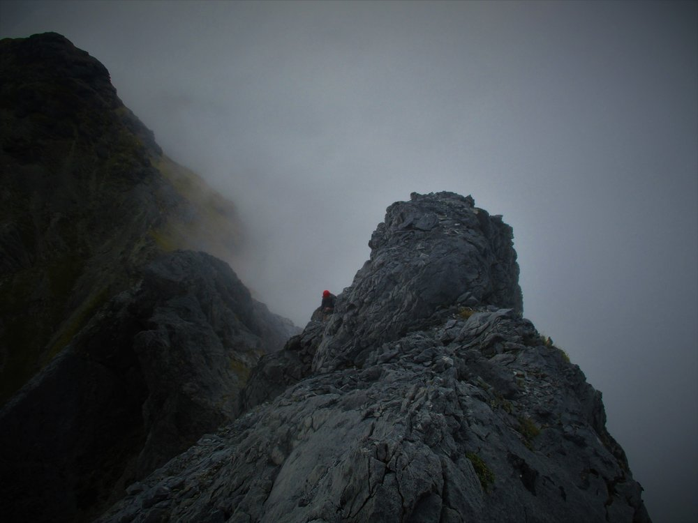 Curtis searching a route on the North Twin
