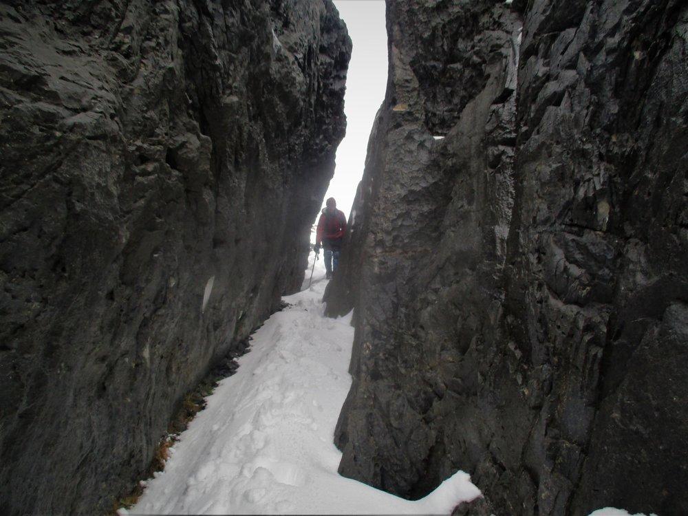 Going thru a Karst crevasse on Mount Arthur