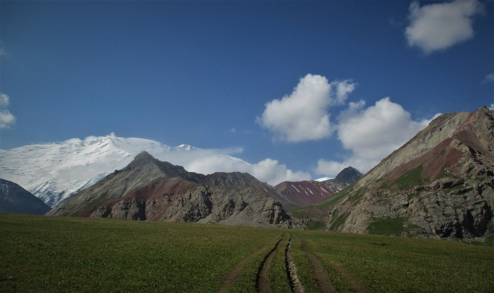 The ease of acess is evident here , a vechile track runs right to the base of Putasestvanikov pass - the gap in the middle of the picture. This pass leads over to the Lenin glacier.