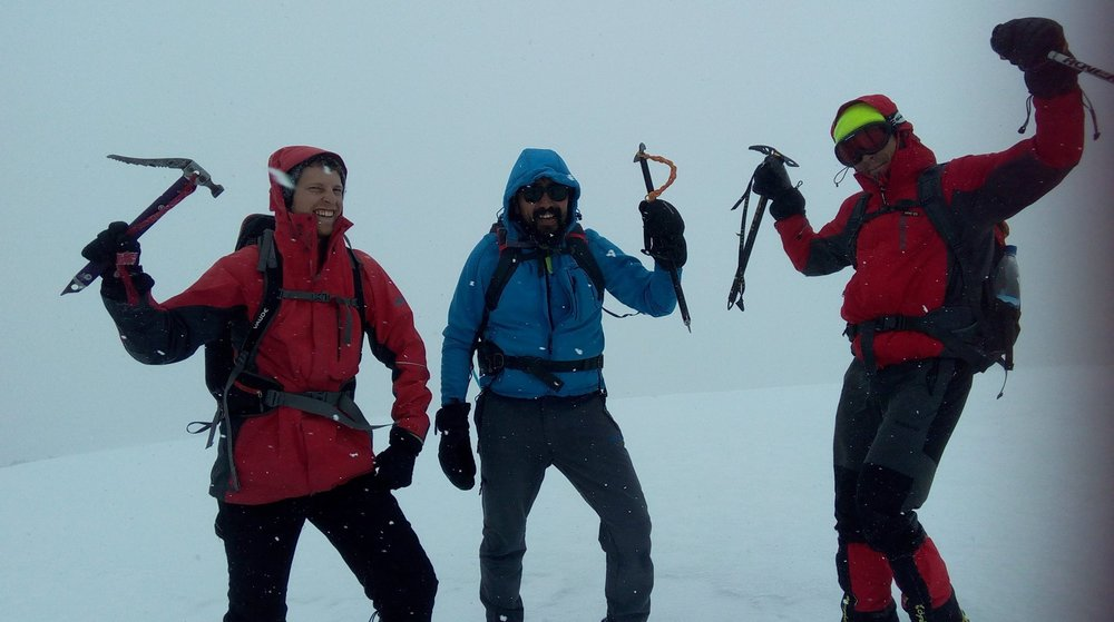Elliot , Vicho and Sergio celebrate with snowflakes on the summit of Angelus