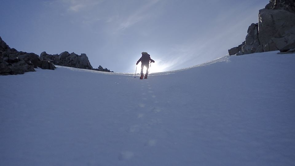 Climbing the long snow coulior that lead to the small resting plateau.