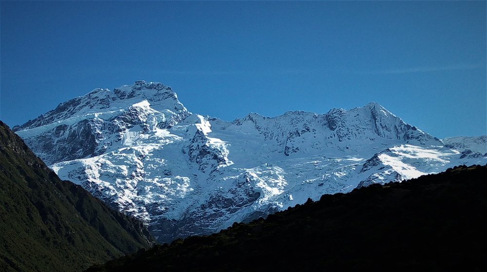 The ice clad Eastern face of Mount Sefton , one of the most spectacular mountain sights in New Zealand.
