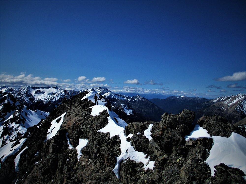 a narrow ridge heading to the summit.