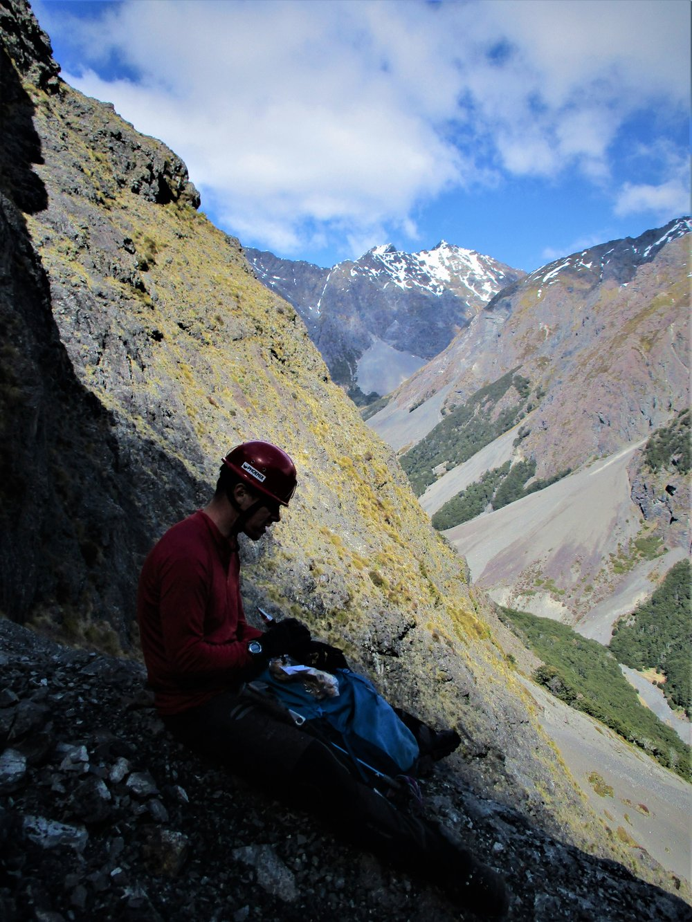 "Jake contemplates our failure on a rock route behind us at the start of the climb.    Desperation peak - that's what I think I'll call it from the amount of times Jake times I heard Jake utter the word ""desperate"" in front of me - been rather faster and more competent than me on treacherous terrain his desperate is my hopeless. Anyway after 3 or more hours trying we finally found a route off first base."