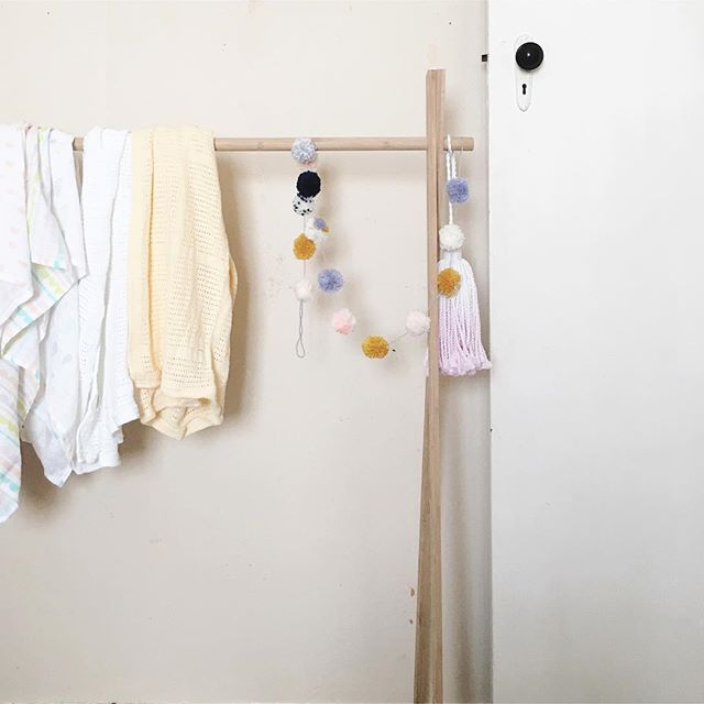 Nursery set up slowly happening... I feel like I have a heavy metal shot put wedged into the top of my v-jay today... Hanging rack by @mockaaustralia  Pom Pom garland by @marsh.mel.lo  Dipped tassel by @makerandmerchant  Wraps from @kmartaus  #nursery #babygirl #decorating #pink #36weeks #36weekspregnant #babysroom #babystyle #pompoms #tassels