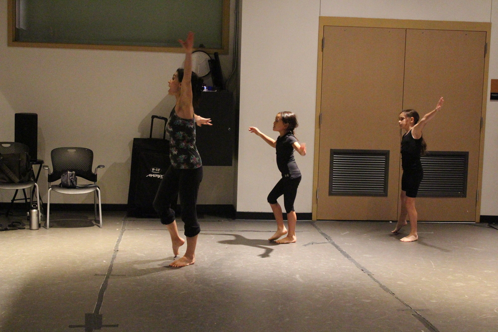 Aisha teaching during dance class. Photo Credit: Autumn Wagman