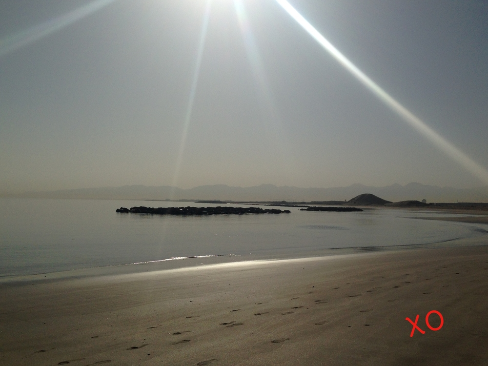 Valentine's Morning, Seeb, Oman. The water is calm and the sun is bright.