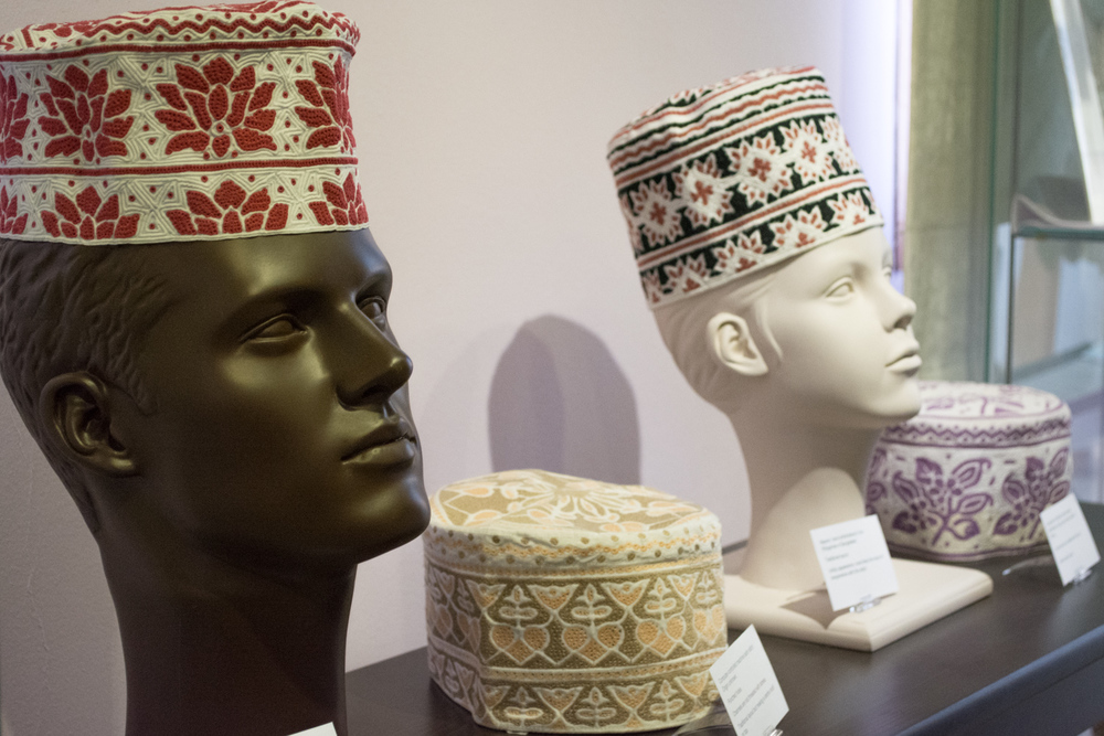 The kuma can be worn alone or under the massar. The embroidery design of the kuma is very specific. The three in the foreground have traditional style embroidery patterns. The side of the cap has a full band of the design around the top and a half band of the design around the bottom.