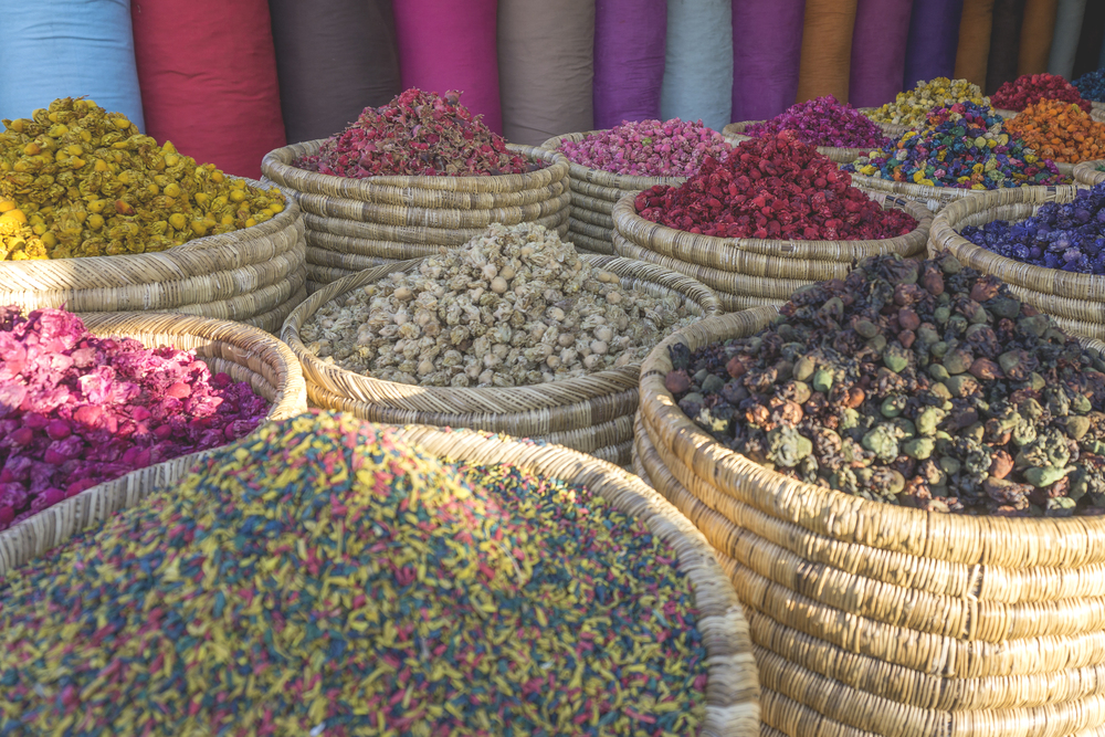 Baskets of dried flowers, souks, the Medina of Marrakech, Morocco
