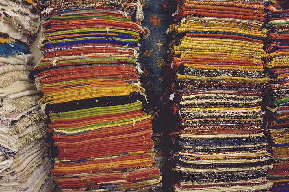 Stacks of rugs, store in souks, the Medina of Marrakech, Morocco