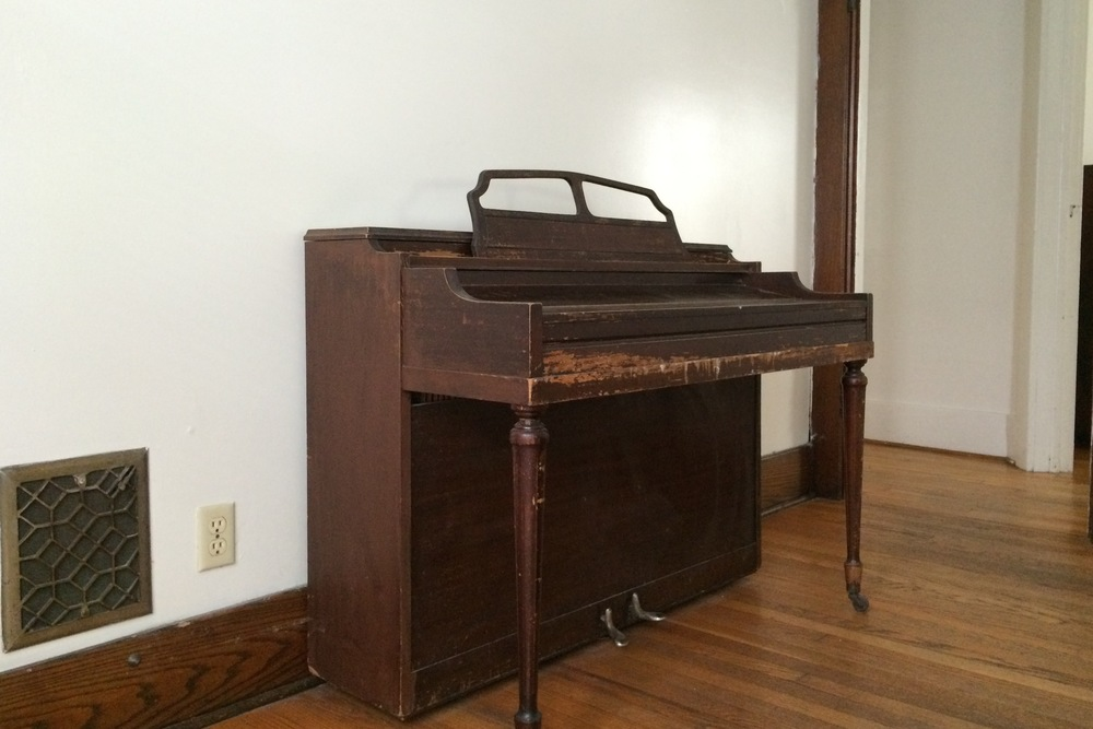 piano (untuned) in dining room