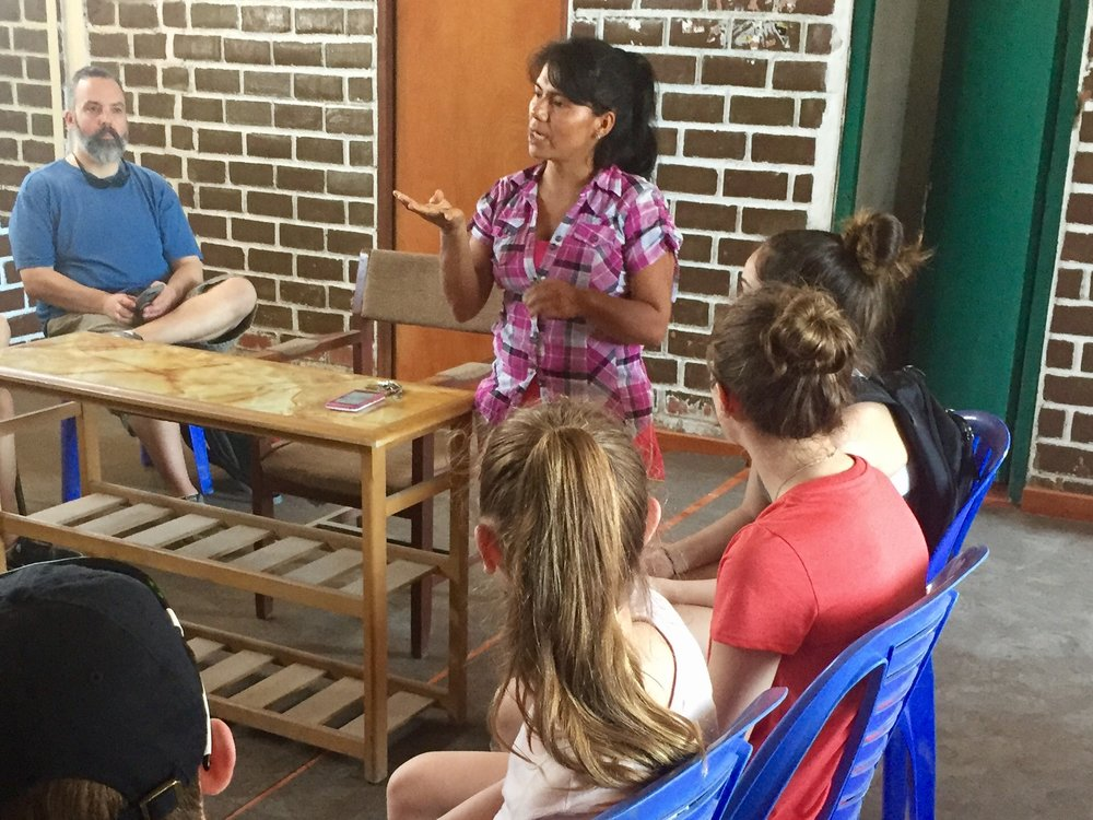 Meeting with a woman who has launch two of her own organizations in Villa El Salvador outside of Lima and preaches a message of hope despite the poverty of the area.