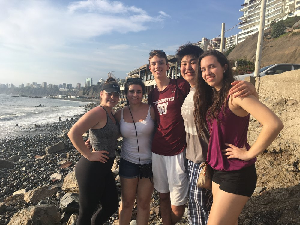 Enjoying a sunny afternoon on the coast of the Pacific Ocean in Lima.