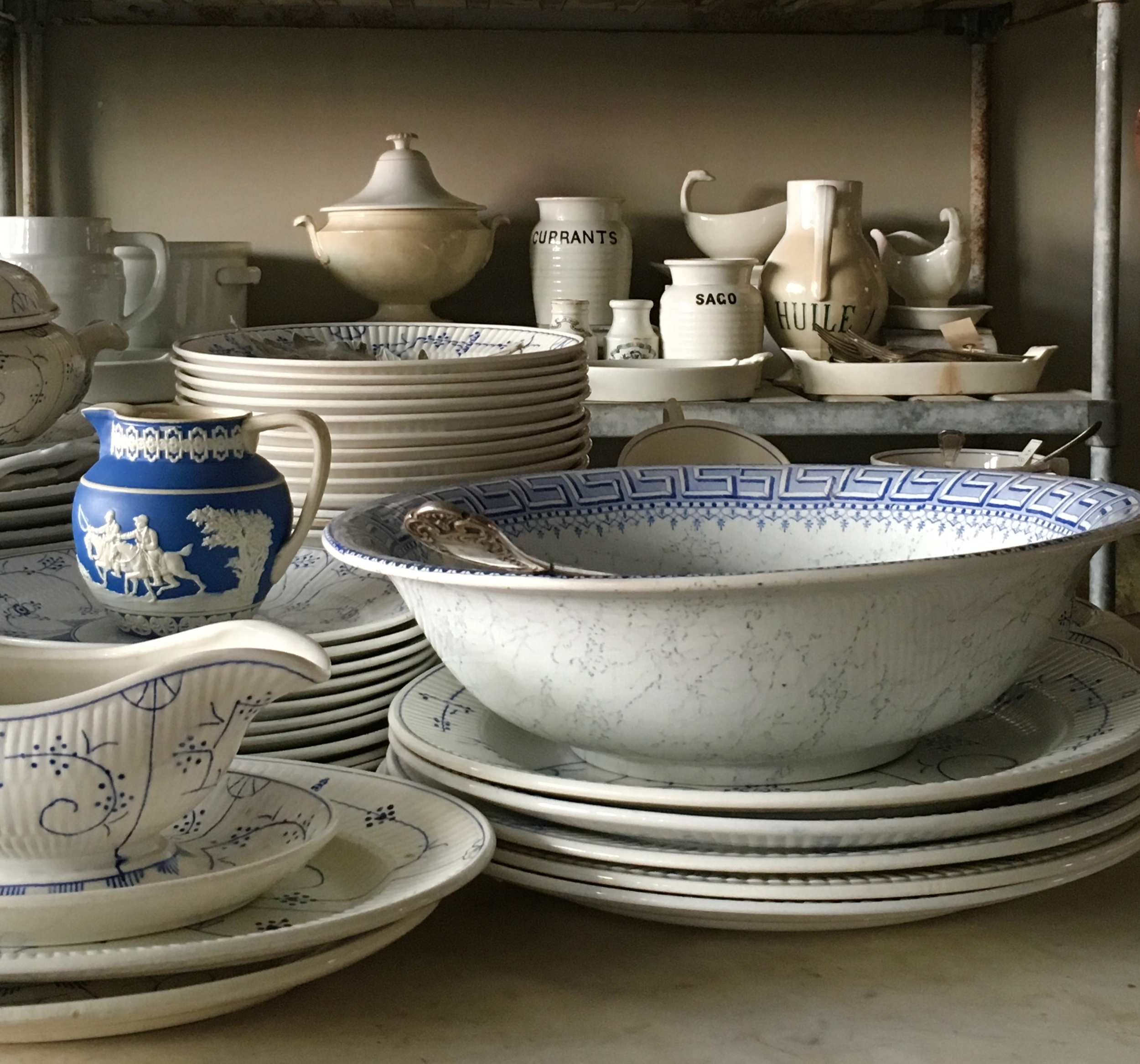 Antique stoneware and dishes at Red Chair on Warren. French Farmhouse White Decorating Ideas.