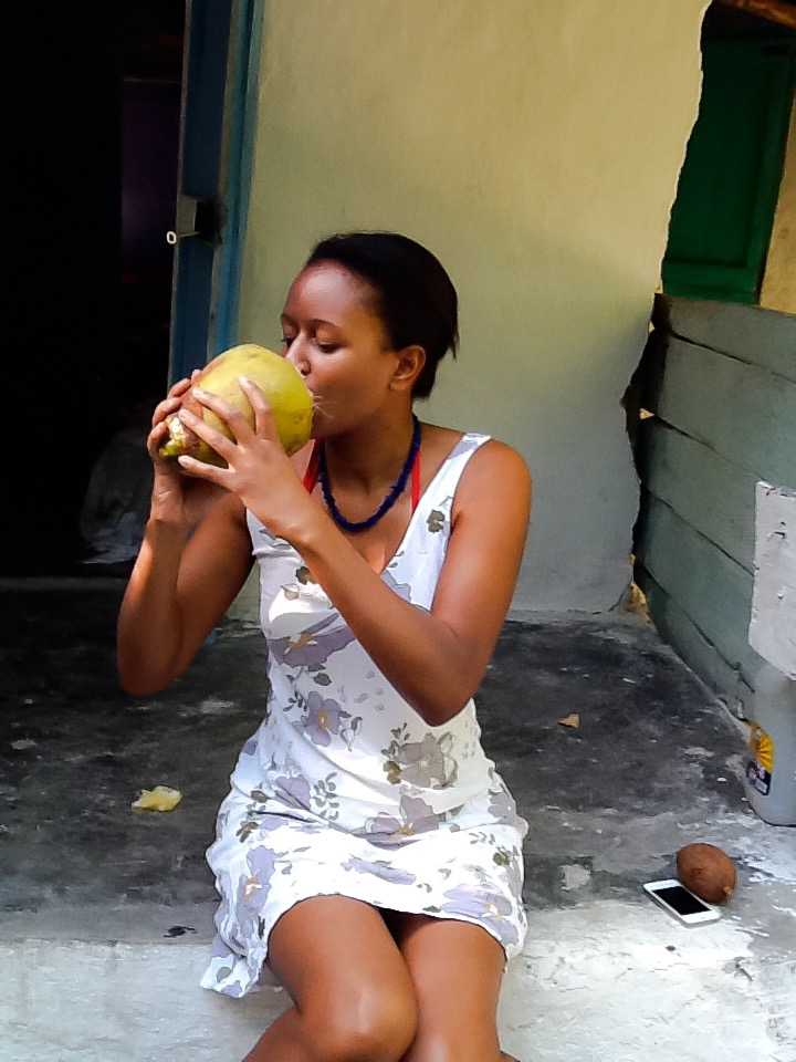 Enjoying coconut in Haiti