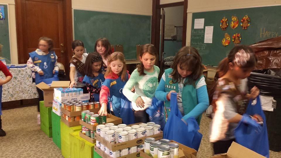 Girl Scouts pack bags.jpg