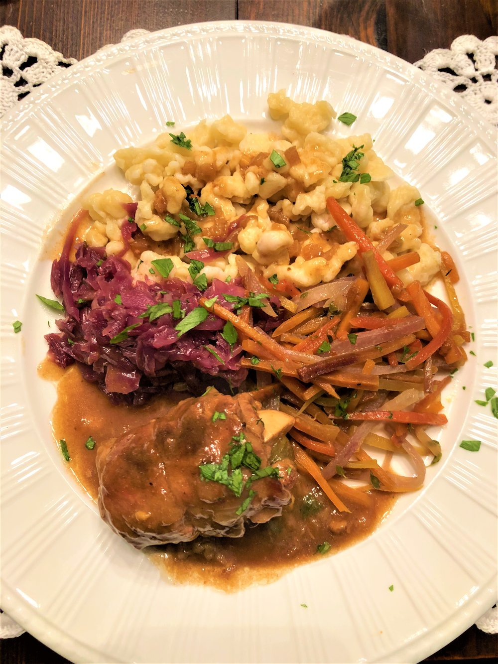 Served with    Rouladen   , dumplings and cabbage