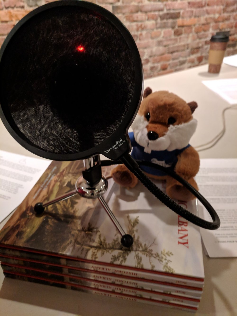 Brom the Beaver, the official Ten Broeck Mansion mascot, guards the mic between takes