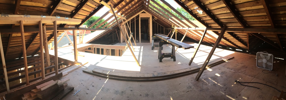 Here's a pano shot of the attic. The master bathroom is what you are looking at. It looks tiny but it won't be. The openings in the roof are where the dormers will be! Big stuff, friends.