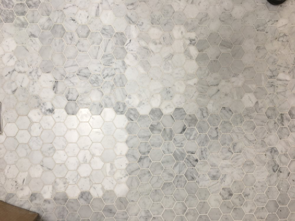 So, our honed hexagonal tile sheets have been installed. And they don't match. This spells headache. Stay tuned for some sort of solution (which escapes me at this late hour).