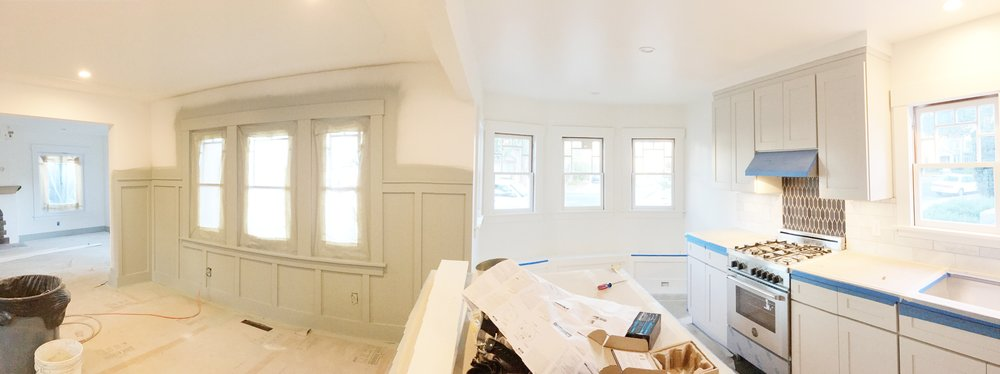 Here is a pano shot of the lower level. You can see the trim sprayed on the dining room wall.