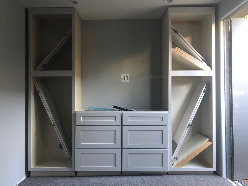 Super simple, inexpensive, gray built-in cabinets from  KZ Cabinets .