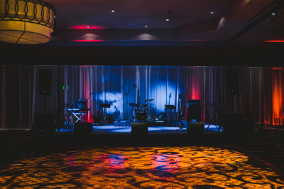 Lighting Lighting Lighting! Up lighting and gobo's are relatively inexpensive tools for upping the drama factor without breaking the bank. Turn that boring ballroom into a magical oasis with perimeter uplighting or gobo's on the walls. Amp up the hotel dance floor with a fun gobo!