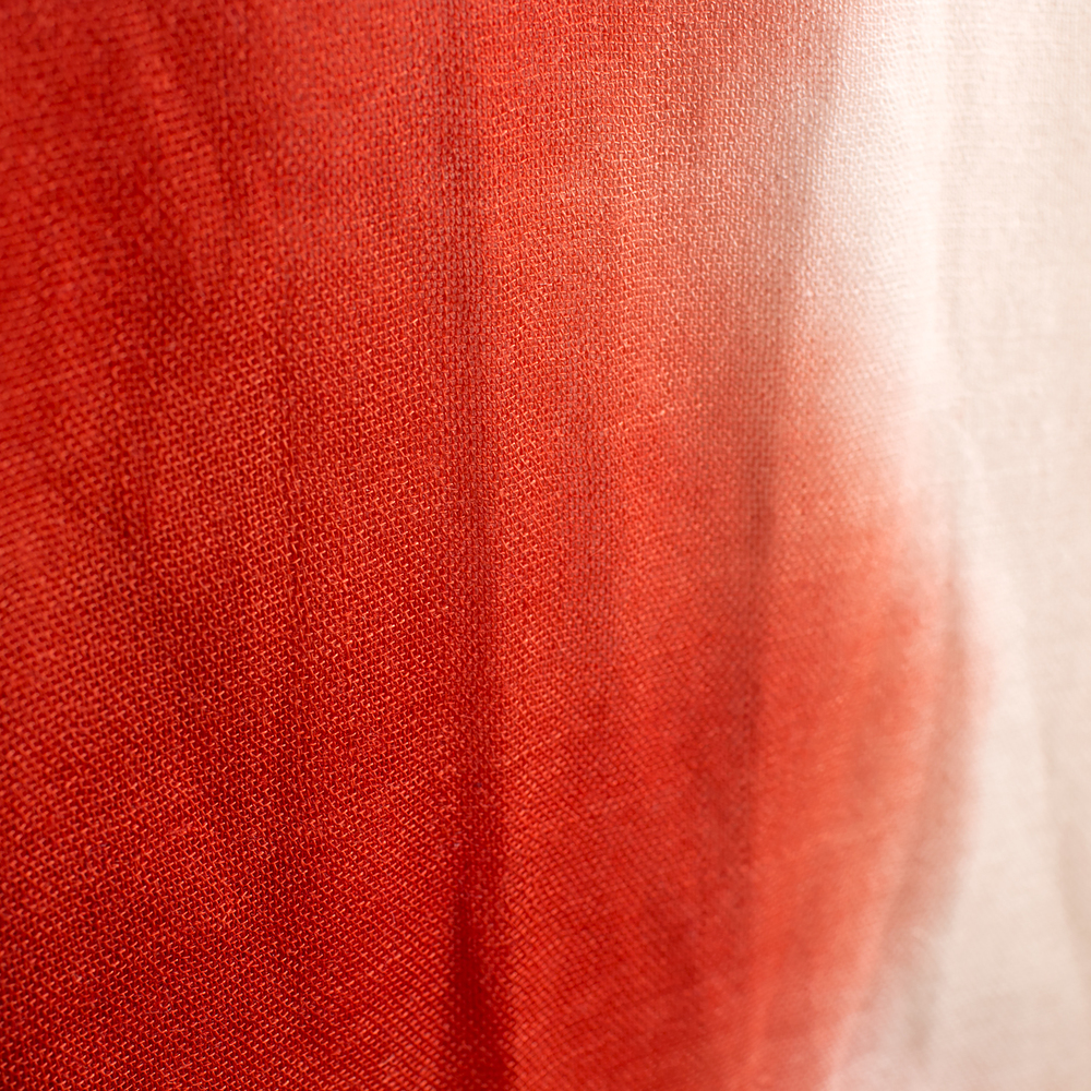 Detail shot of our Tissue Weight Red Tie Dye Shawl