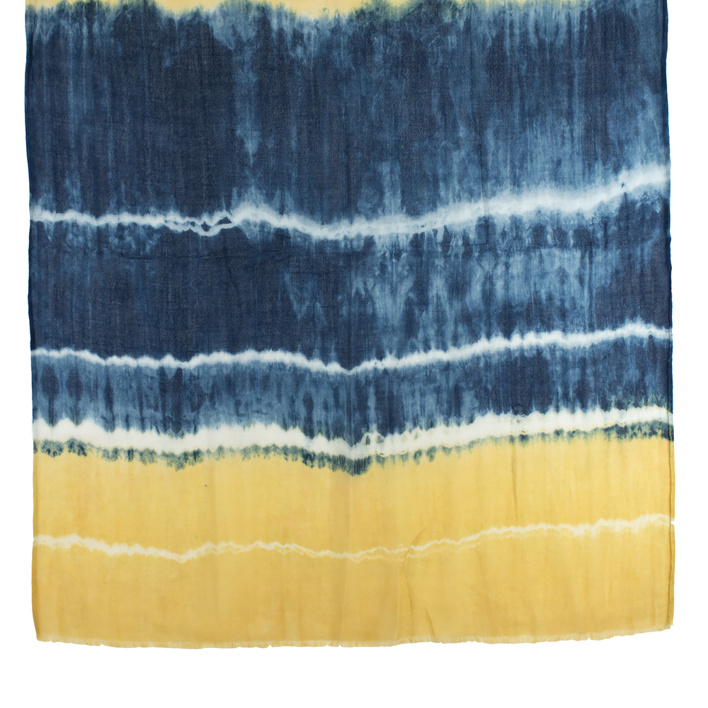 Our Tie Dyed shawl is made from indigo and botanical dyes