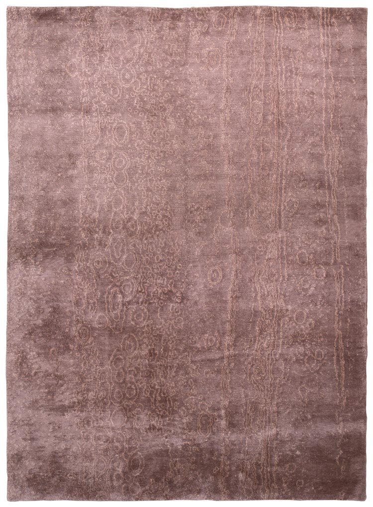 Our strata design is abstract and nature inspired. Woven in a warm cinnamon brown tone in a silk shag. This carpet is made with all natural dyes