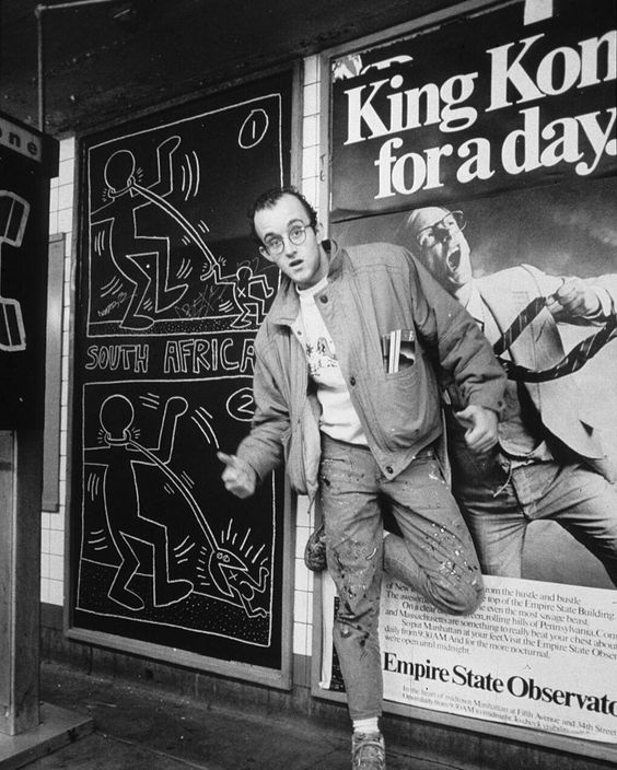 Keith Haring in front of a subway drawing, 1983