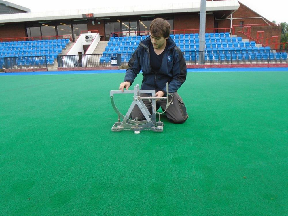 Tom testing a hockey field