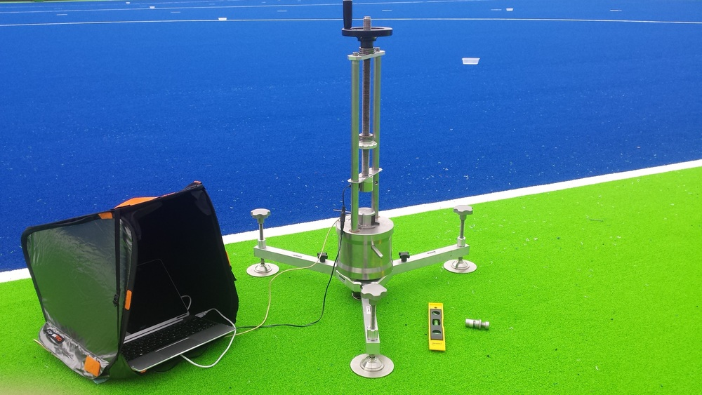 This photo shows the Advanced artificial athlete testing the artificial turf system at the Olympic venue
