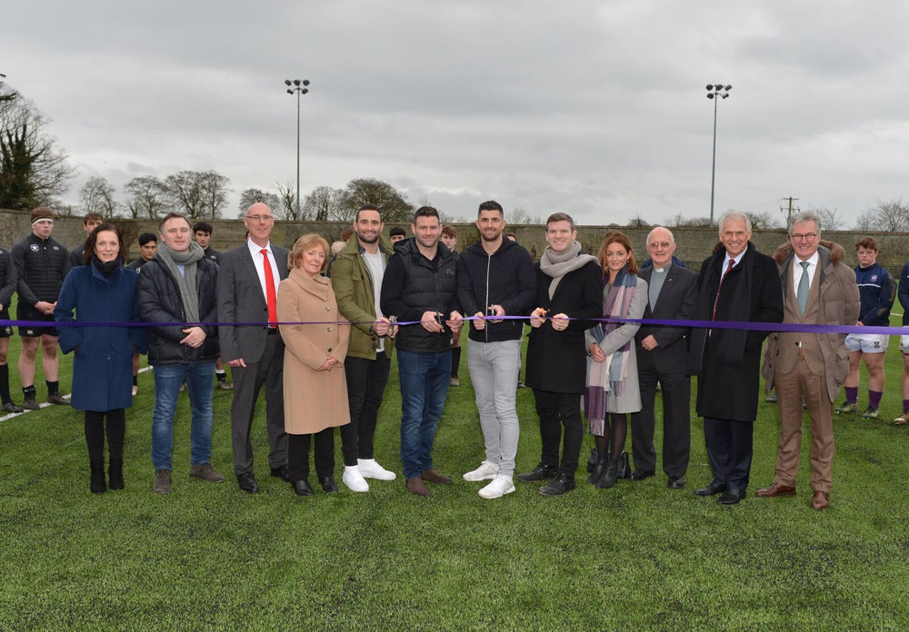Cutting the Ribbon - The state-of-the-art facility was blessed by the Rector, Fr Michael Sheil SJ before the purple- ribbon was cut by Clongowes four most recent rugby internationals, Gordon D'Arcy, Rob and Dave Kearney, and Fergus McFadden. The Vinny Murray Pitch or VMP – as it is known – was named in memory of the late Assistant Headmaster and legendary rugby coach, who passed away in 1999. Saturday's event was bracketed between a Junior and a Senior match against Campbell College, Belfast and followed some words of introduction, reminiscence and celebration from the Headmaster, Mr Chris Lumb.